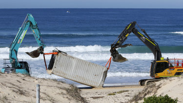 One of the shipping containers is salvaged from Birdie Beach on the Central Coast of NSW on Thursday.