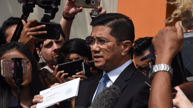 Mohamed Azmin Ali has been accused of appearing in a leaked sex tape - a claim he denies.