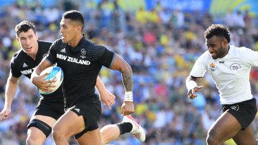 Streaker: Etene Nanai-Seturo breaks free before scoring against Fiji in the final at Robina Stadium.