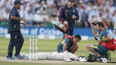 Steve Smith receiving treatment as he lies on the ground after being hit on the head by a ball bowled by England's Jofra Archer.