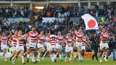 Four more years, two more scalps: Japan in 2015 celebrating the first of their big World Cup upsets.