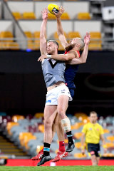 Melbourne's Max Gawn battles Peter Ladhams.