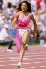 Florence Griffith Joyner runs down the track during the Olympic Trials in 1988.