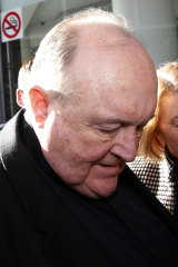 Archbishop Philip Wilson arrives for sentencing at Newcastle Local Court.
