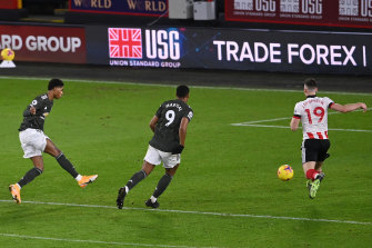 Marcus Rashford scores United's third and his second at Bramall Lane.