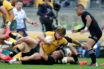 Michael Hooper is tackled during last week's Bledisloe epic in Wellington.