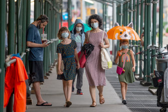 A family in New York City wearing masks.