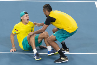 Alex De Minaur and Nick Kyrgios celebrate their epic doubles win over Great Britain at Ken Rosewall Arena.