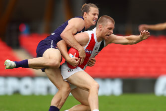 St Kilda's Seb Ross is wrapped up by Docker Nat Fyfe on Saturday.