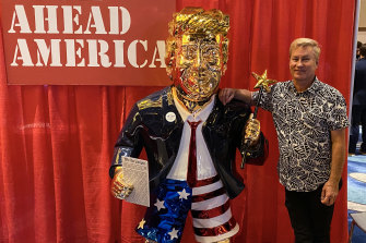 Tommy Zegan with his golden Donald Trump statue at the Conservative Political Action Conference in Orlando.
