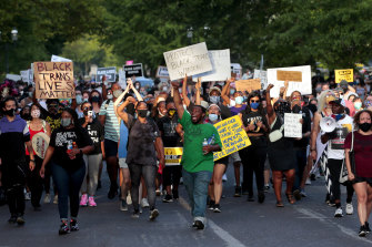 Hundreds of protesters march down Waterman Boulevard headed to St Louis Mayor Lyda Krewson's home on Sunday.