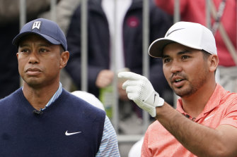 Tiger Woods (left) sympathises with Jason Day's infrequent appearances in Australia.