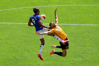 Everton's Dominic Calvert-Lewin and Romain Saiss for Wolves challenge for the ball