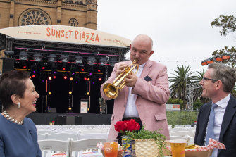 NSW Treasurer Dominic Perrottet and City of Sydney Lord Mayor Clover Moore with Australian jazz legend James Morrison at the launch of Sunset Piazza, Cathedral Square.