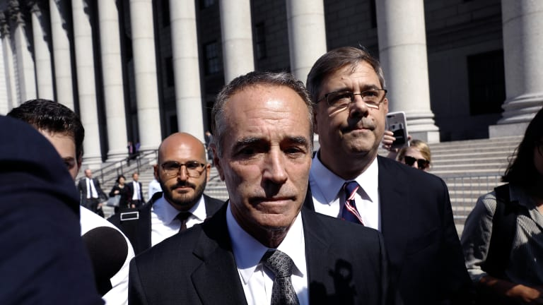 Representative Christopher Collins, a Republican from New York, exits federal court in New York.