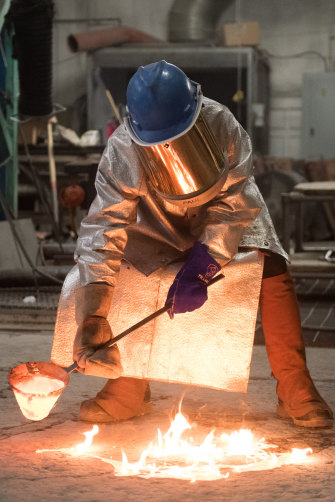 Lindy Lee working on her flung bronze works at the Foundry in Brisbane.