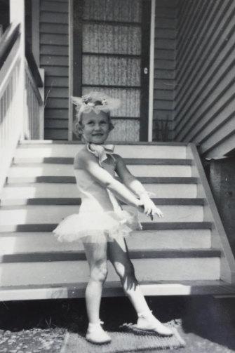 Manfield aged seven, in her Brisbane backyard.