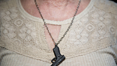 A woman wears a necklace at the National Rifle Association's annual meeting in Dallas, Texas, in May.