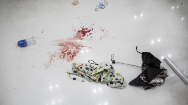 Blood stains are seen next to umbrellas on the ground following the clashes.