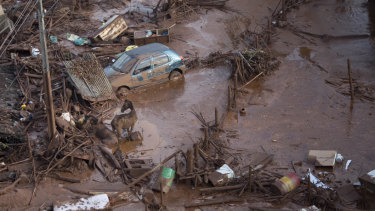 Rescuers searched feverishly for possible survivors for days after Samarco's Fundao dam burst on November 5, 2015.