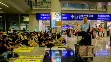 Demonstrators stage a protest at Hong Kong International Airport.