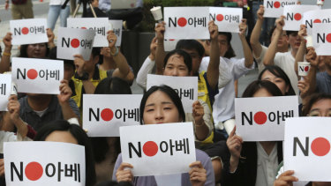 """Protesters stage a rally in front of the Japanese embassy in Seoul, South Korea denouncing the Japanese government's decision on their exports to South Korea. The signs read: """"No (Japanese PM) Abe."""""""
