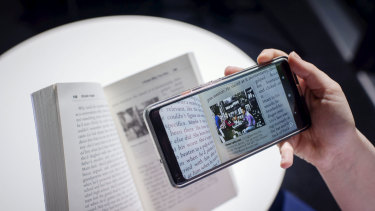Readers use an augmented reality app to watch video content that is part of Khyiah Angel's novel I Know Why You Run.
