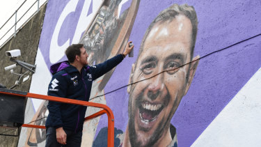 He's a Melbourne institution: Ryan Hoffman adds a few extra touches to the Cam400 mural at Richmond train station.