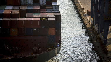 Maritime workers wait to dock at a Brazilian port.