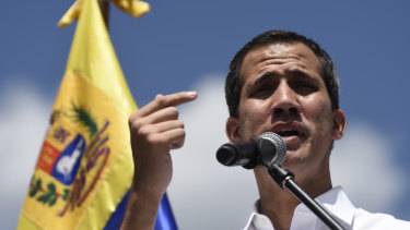 Juan Guaido, president of the National Assembly who swore himself in as the leader of Venezuela, speaks during a meeting of aid volunteers in Caracas, Venezuela, on Saturday.