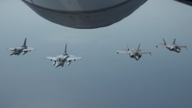 UAE Desert Falcons fly in formation with US F-35A Lightning IIs in an undisclosed location in south-west Asia. The flight was conducted to continue building military-to-military relationship with the UAE, according to the US Air Force.