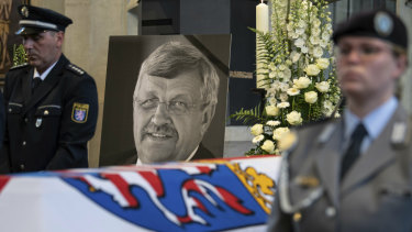 A picture of Walter Luebcke stands behind his coffin during the funeral service in Kassel, Germany in June.