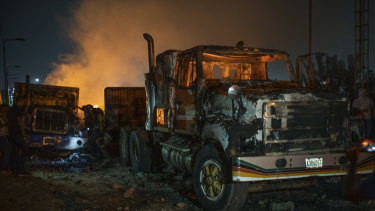 Burnt trucks previously loaded with humanitarian aid sit on the Francisco De Paula Santander International Bridge near the border with Venezuela in Cucuta, Colombia, on Saturday.