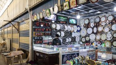Clocks are displayed at a stall inside the main bazaar Xinjiang.