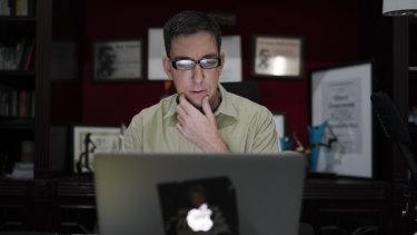 American journalist Glenn Greenwald checks his news website, The Intercept, at his home in Rio de Janeiro, Brazil.