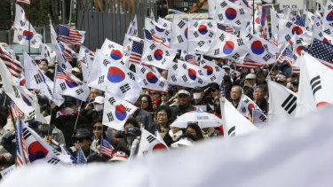 Supporters of former South Korean President Park Geun-hye stage a rally to call for her release earlier on Friday.