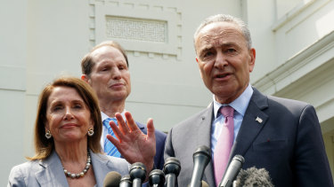 Senate Minority Leader Chuck Schumer, a Democrat from New York, right, speaks to members of the media as US House Speaker Nancy Pelosi, a Democrat from California, left, smiles after a meeting with US President Donald Trump at the White House in Washington, DC.