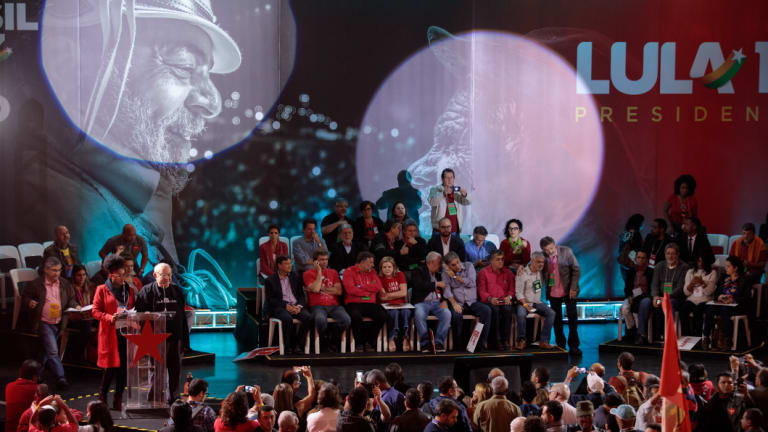 Members of the Workers' Party sit on stage during the party's national convention in Sao Paulo, on Saturday.