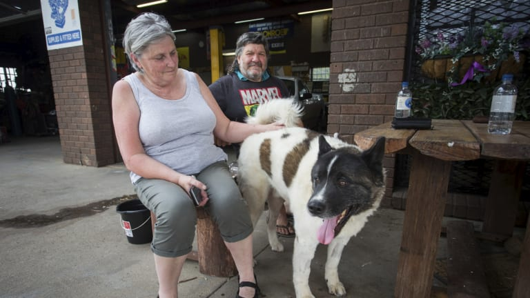 Maryanne and Sam Pernice at Little River General Store. Mr Pernice fled their Narraburra Road farm with their dog Brutus as the fire approached.
