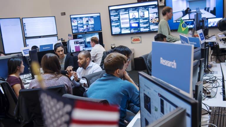 "Employees work inside Facebook's ""War Room"" ahead of Brazil's run-off election in Menlo Park, California."
