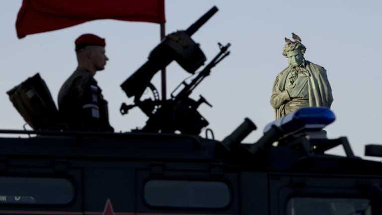 A Russian soldier rehearses for a Victory Day military parade in May.
