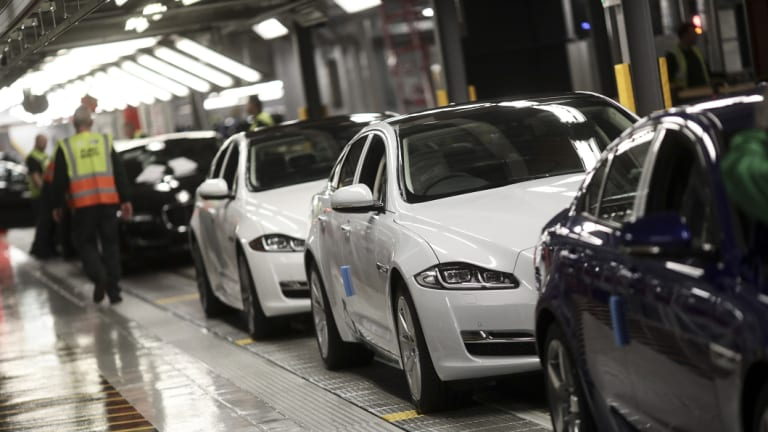Jaguar automobiles move on a conveyor belt through an assembly plant in Castle Bromwich, UK.