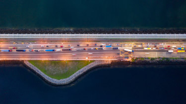 Vehicles travel along the Causeway across the Strait of Johor between Singapore and Malaysia.
