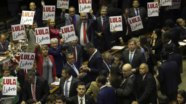 """Opposition lawmakers hold """"Free Lula """" placards during the new House of Representatives inaugural ceremony in Brasilia last week."""