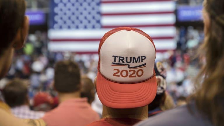 """Looking forward: An attendee wears a """"Trump 2020"""" hat in Wilkes-Barre."""