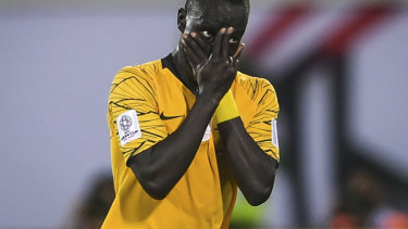 Peace of mind: Awer Mabil sends a message after scoring against Syria on Tuesday.