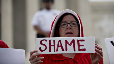 A demonstrator dressed in 'Handmaid's Tale' costume protests against the apparently pro-life US Supreme Court.