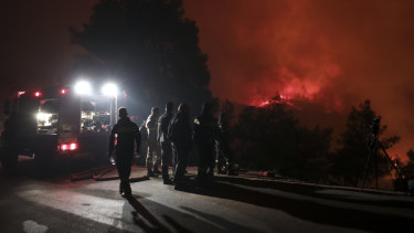 Hundreds of firefighters battled wildfires in Greece on Tuesday, with the largest burning out of control through a thickly forested nature reserve on the island of Evia.