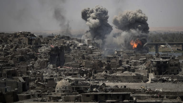 Airstrikes target Islamic State positions on the edge of the Old City in Mosul.