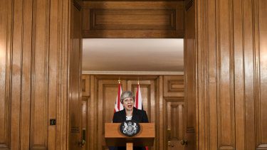 UK Prime Minister Theresa May makes a statement inside number 10 Downing Street.